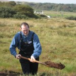 Modelling a peat spade. Pained expression mandatory.