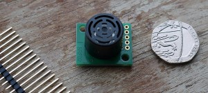 SRF02 sensor. About the size of 20p.